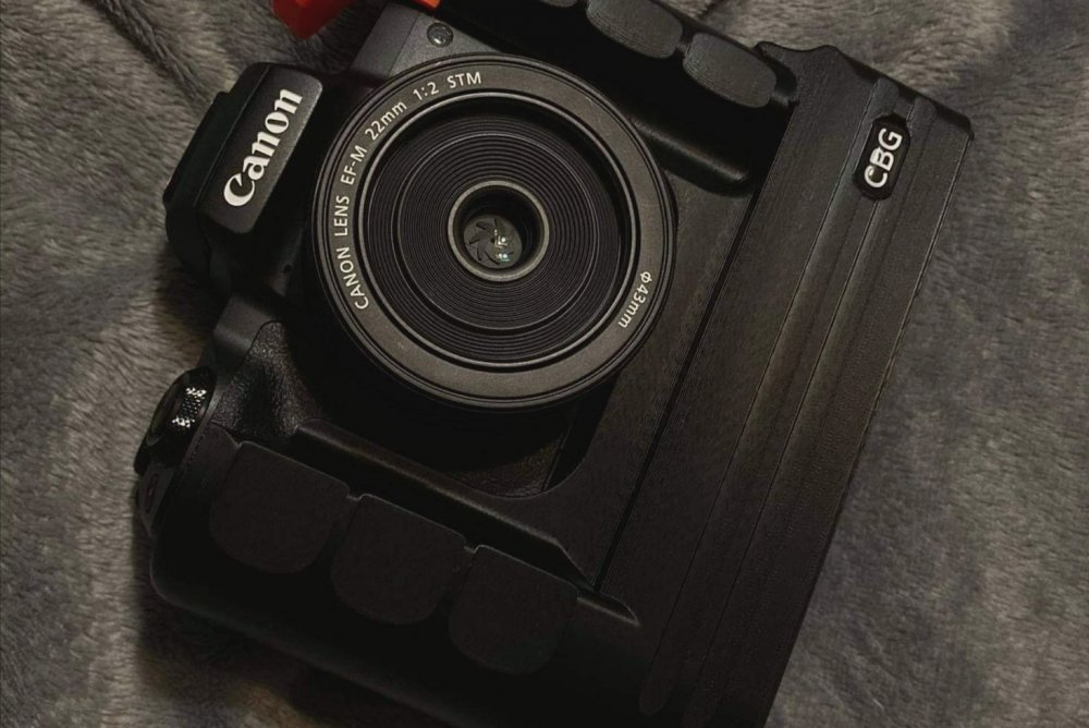 Our Extended Battery Grip for Canon EOS M50 with orange cold shoe